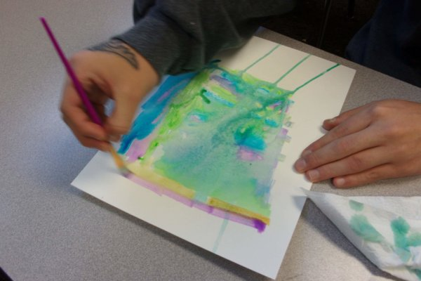 """Students at a Youth-In-Custody facility participated in an art-science workshop and learned about the concept of turbulence and the effects that the turbulent properties of water have on watercoloring. Students then made watercolor """"flexigons"""" with abstract designs and haikus"""